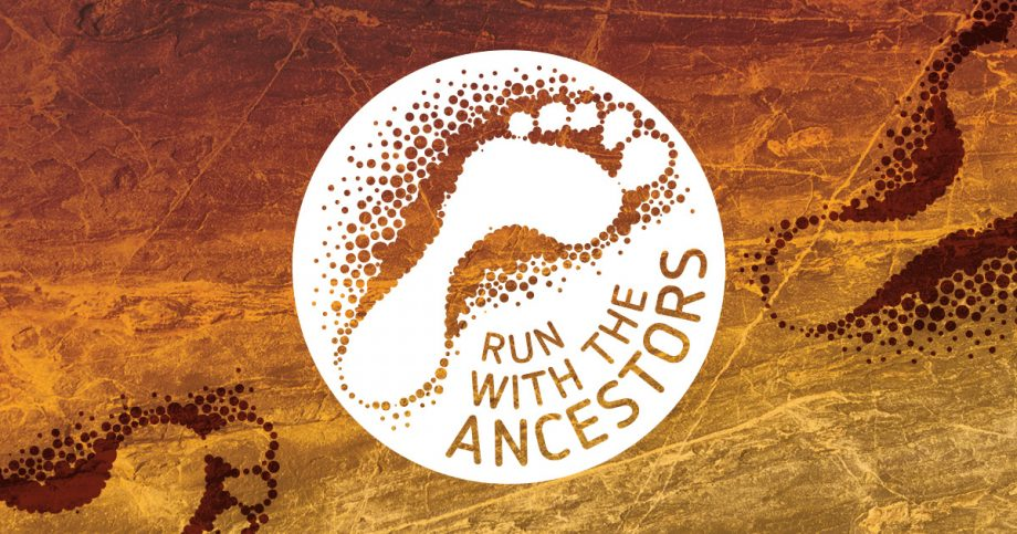 A white footprint in a circle with the text Run with the Ancestors alongside it