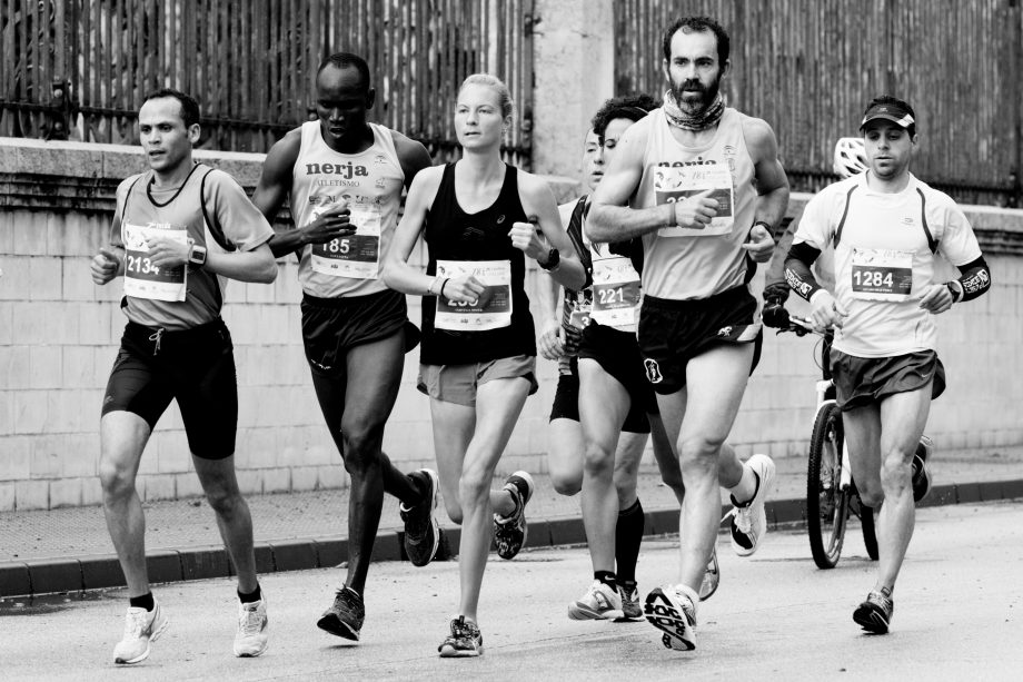 Group of male and female runners in black and white