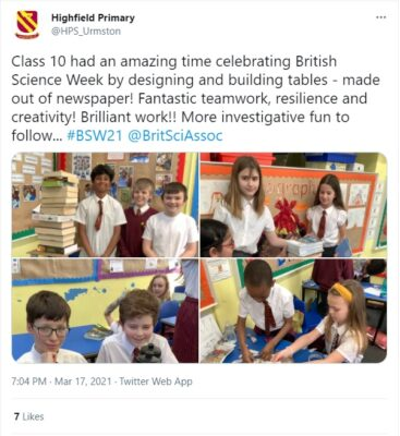 A screenshot of a tweet from Highfield primary school showing small children building tables out of newspaper